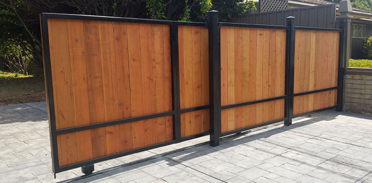 Up the Beauty of Your Property with a Sliding Wood Gate